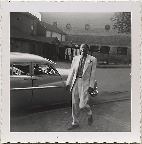 NATTILY DRESSED AFRICAN-AMERICAN BLACK MAN SAUNTERS PAST VINTAGE CAR