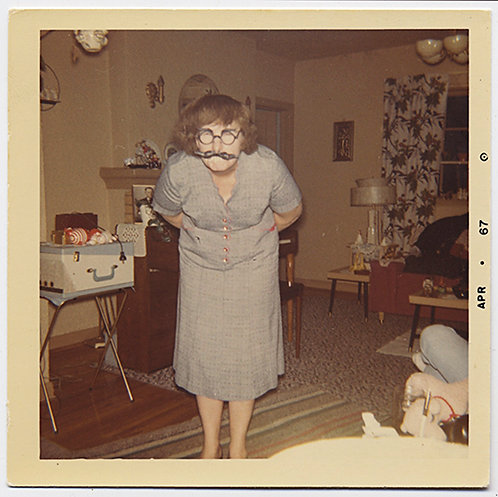 SPOOKY WOMAN  in GRAY BENDS OVER in FUNNY GLASSES and MOUSTACHE MASK