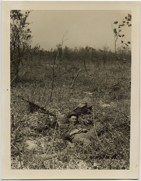 ALMOST CAMOUFLAGED SOLDIER takes NAP in BRUSH WOODED LANDSCAPE VIETNAM? KOREA?