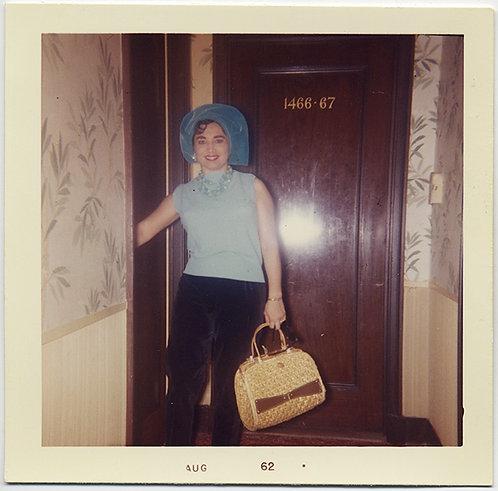 LOVELY YOUNG WOMAN outside ROOM 1466-67 WEARS STRANGE HAT WICKER BAG FLASH