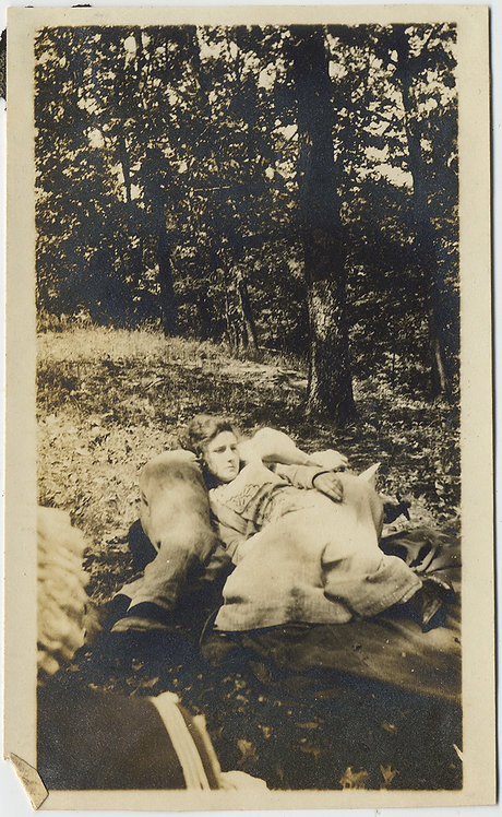 LAZY LAYING LOVERS LIE INTERTWINED in DAPPLED SUNLIGHT after PICNIC ROMANCE