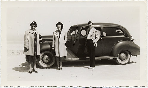 STARK THREESOME with VINTAGE CAR on SALT FLAT?  BEACH FRONT? WHITE BACKGROUND