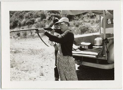 ANNIE GETS HER GUN! OLDER WOMAN MARKSMAN AIMS RIFLE SHOTGUN at UNSEEN TARGET
