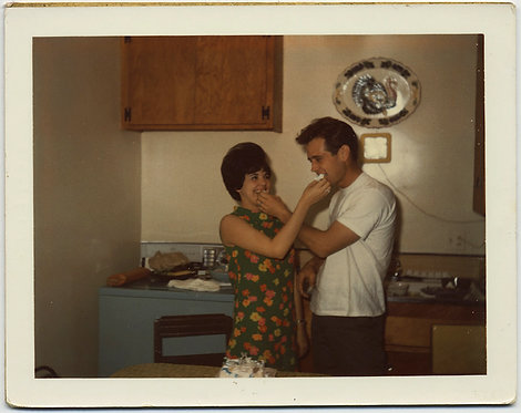 70s COUPLE FEEDS EACH OTHER CAKE in KITCHEN POLAROI