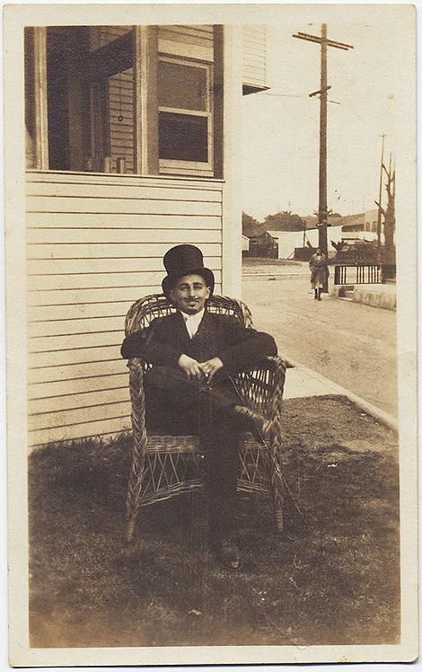 UNUSUAL MAN in TOP HAT and FAKE MOUSTACHE on WICKER CHAIR!