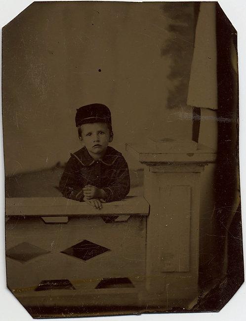 LOVELY CAP WEARING LITTLE BOY in STUDIO PORTRAIT w PROP FENCE & BACKDROP