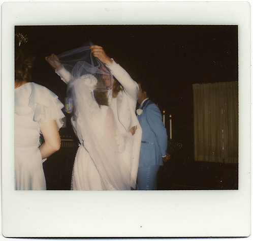 ALMOST ABSTRACT FACELESS GROOM LIFTS BRIDE'S VEIL in KODAK INSTANT POLAROID