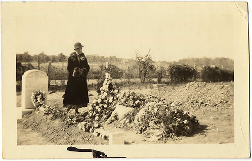 "OLD WOMAN at NEWLY DUG GRAVE MOUND COVERED w. FLOWERS ""GrandPa's grave"" CAPTION"