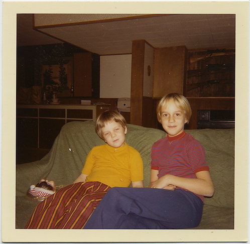 COLORFUL BLONDE BOYS HANG OUT on COUCH in MIDCENTURY INTERIOR