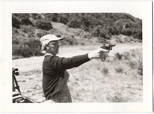 AUNT THERESA AIN'T NO MOTHER TERESA POINTS SHOOTS GUN FIERCE FEMALE SHARPSHOOTER