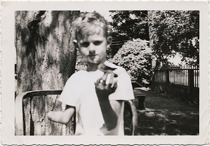fp2721(Boy_Amputee_HoldingBird_Garden)