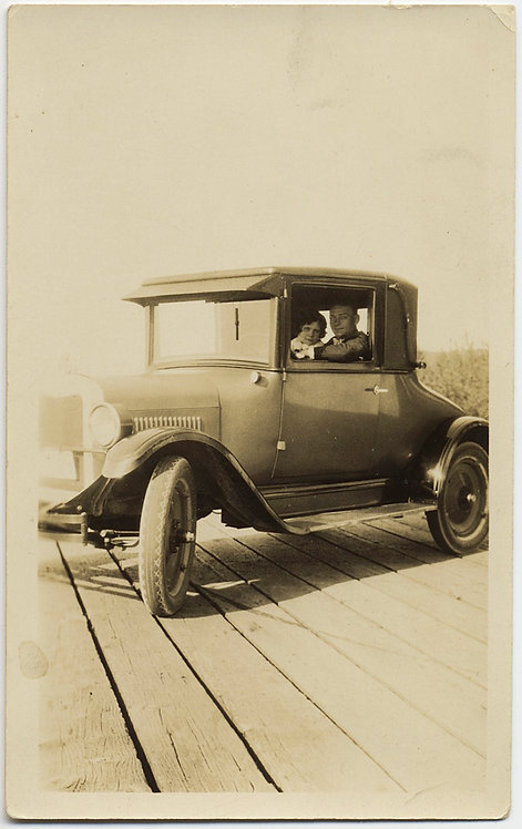 COUPLE DRIVE EARLY VINTAGE CAR on BOARDWALK UNUSUAL