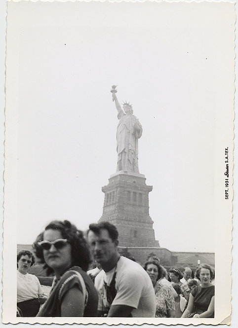 UNHAPPY TOURIST in SUNGLASSES GIVES PHOTOGRAPHER STINK EYE at STATUE of LIBERTY!