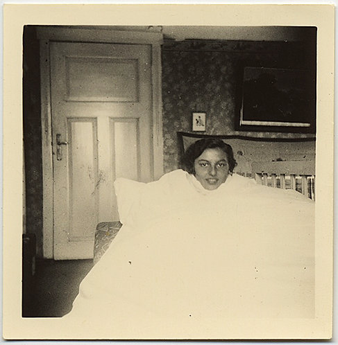 WOMAN in INTERIOR ROOM COVERED by WHITE SHEET in BIZARRE PORTRAIT