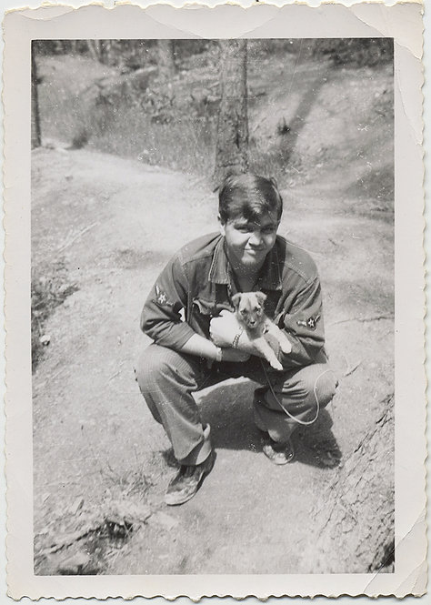 CUTE YOUNG SOLDIER HOLDS CUTER LITTLE PUPPY DOG in ARMS