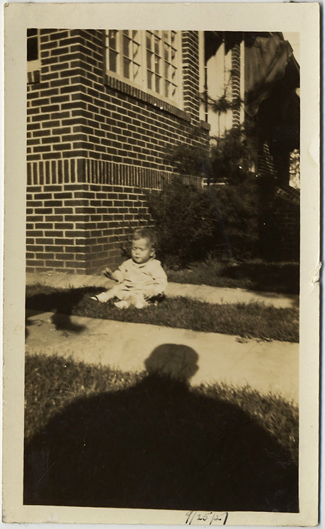 BABY MENACED by HUGE LOOMING SHADOW of PHOTOGRAPHER
