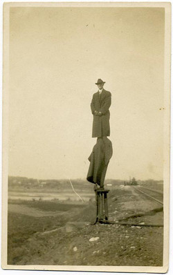 fp1382 (man standing elevated at railroad siding)
