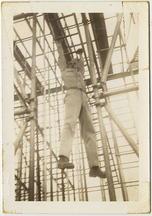 "MAN in UNIFORM? HANGS SUSPENDED fm JUNGLE of SCAFFOLDING ""INCLINED HAND LADDER"""