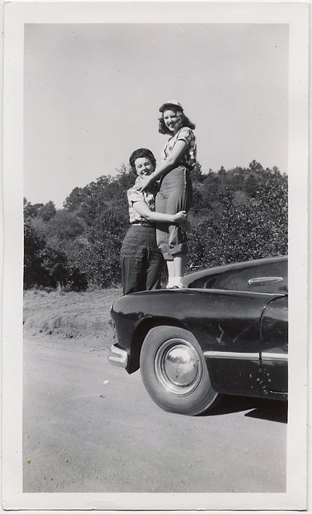 TWO PRETTY YOUNG WOMEN EMBRACE on VINTAGE CAR LESBIAN INT at GARDEN of the GODS