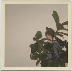fp4970(Woman_Hiding_Plant)