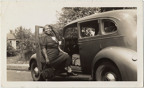 PROUD BLACK AFRICAN-AMERICAN WOMAN poses at VINTAGE CAR
