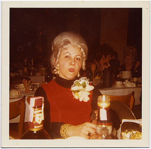 WOMAN in RED, PLATINUM BLONDE WIG, HUGE MAGNOLIA CORSAGE STICKS out TONGUE!