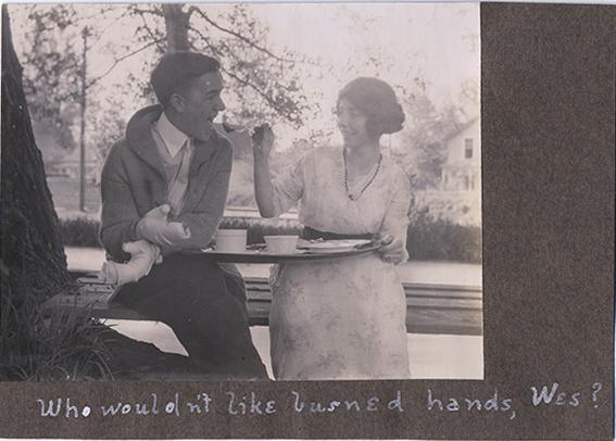 fp4896(Man_BandagedHands_WomanFeeding)