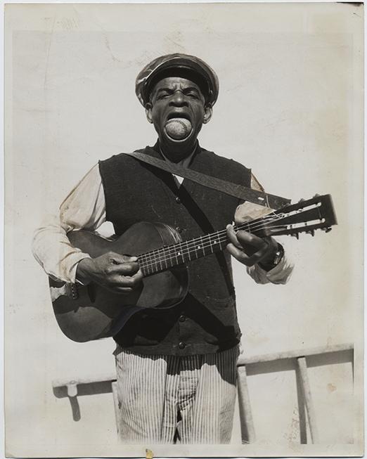 fp2521(PF_ACME_AfricanAmericanMan_BaaseballMouth_Guitar)