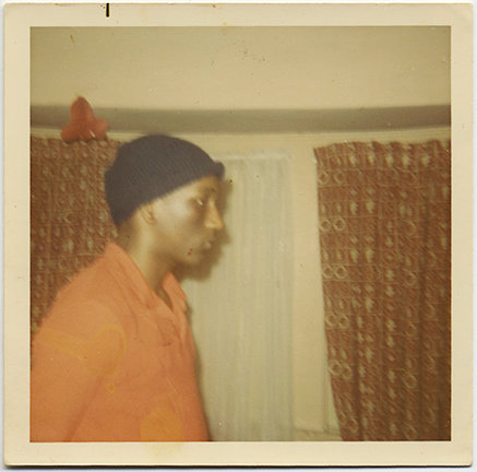 AFRICAN AMERICAN MAN in ORANGE SHIRT JUMPSUIT? STERN PROFILE