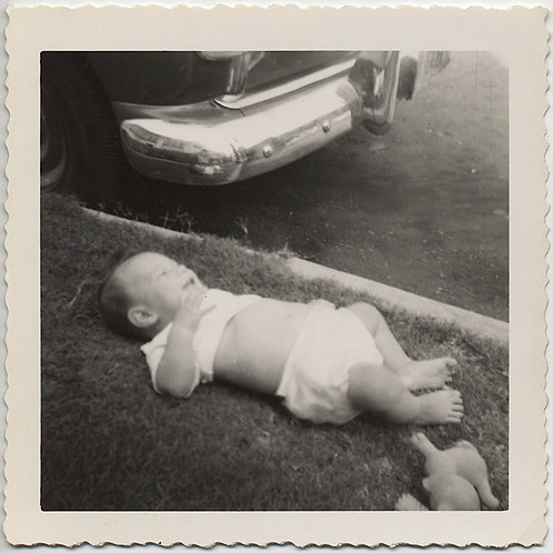 SURREAL BIG BABY LIES on GRASS on ROAD CURB VINTAGE CAR FENDER
