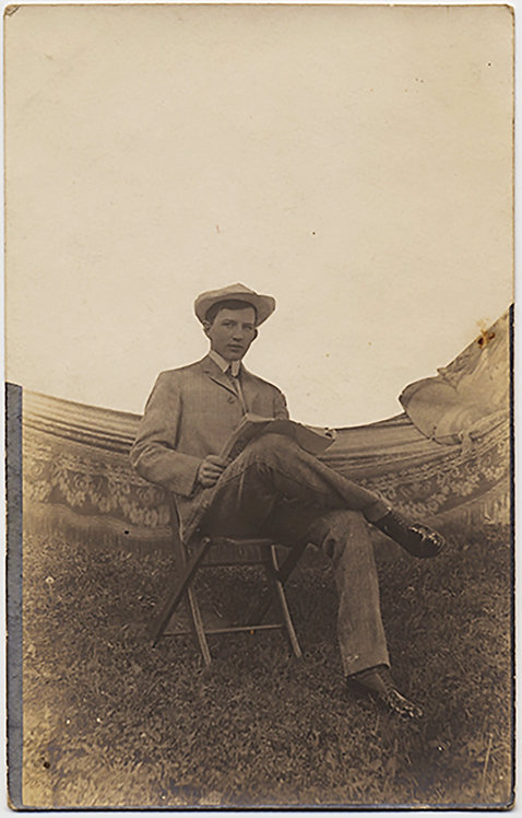 RPPC MAN READS NEWSPAPER near HAMMOCK in ALTERED NEGATIVE MASKED IMAGE