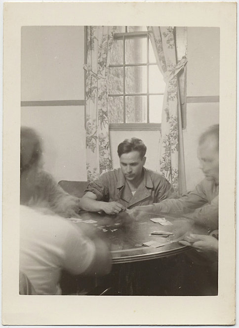 INTENSE MAN CONCENTRATES while MOVING MEN PLAY CARD GAME POKER?