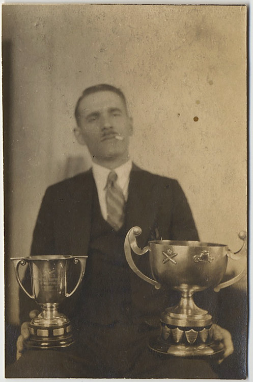 PROUD SMOKING MAN DISPLAYS BIG TOURNAMENT TROPHY CUPS