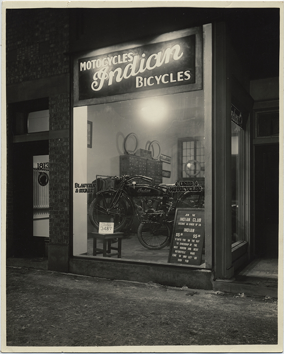 fp5380(Blauvelt&Stewart_MotorcyclesIndianBicycles_ShopWindow_BecomeOwnerOfAnIndian)