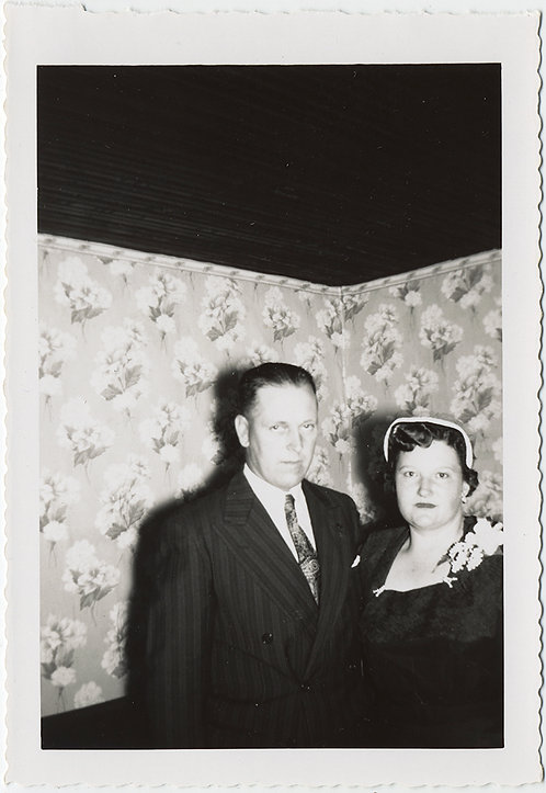 UNUSUAL COMPOSITION SERIOUS COUPLE against FLORAL WALLPAPER & BLACK VOID