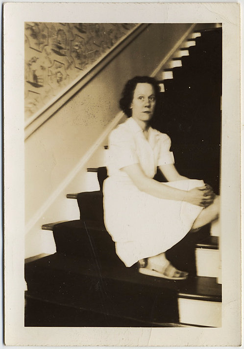 SERIOUS SOLEMN SOULFUL WOMAN on DARK STAIRS
