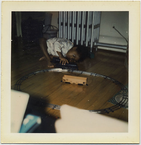 LITTLE BLACK AFRICAN AMERICAN KID BOY PLAYS w TOY TRAIN on TRACK CONCENTRATION!