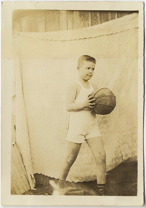 YOUNG KID w BASKETBALL PORTRAIT against BEDCOVER HANGING on WASHING LINE