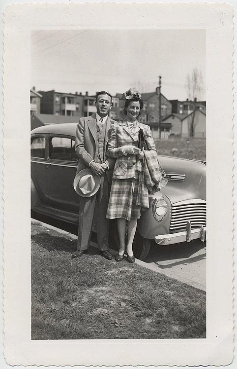 WOMAN in PLAID SUIT & HUSBAND in SUIT in FORMAL VINTAGE CAR PORTRAIT