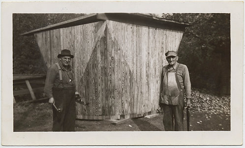 TWO OLD CARPENTERS PROUDLY STAND next to UNUSUAL STRANGE WOODEN STRUCTURE
