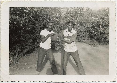BLACK MEN AFRICAN AMERICANS in FRIENDLY STRUGGLE over BASKETBALL