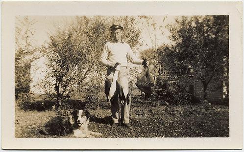 HUNTER JOHN w HIS BAG of WILD GEESE HUNTING DOG at EASE