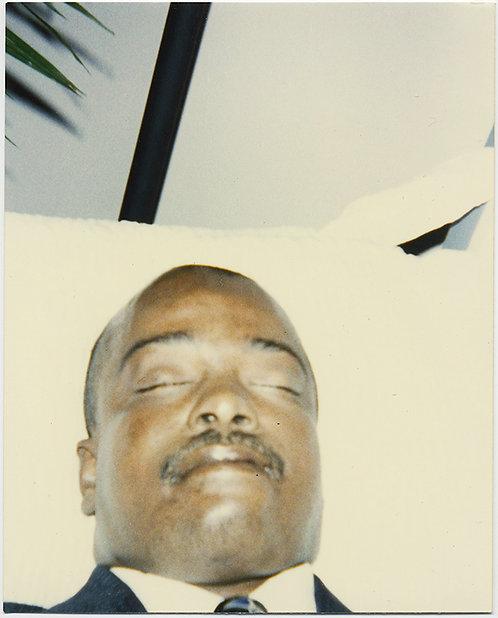 SUPER UNUSUAL POST MORTEM CLOSE UP of BLACK MAN in COFFIN