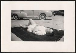 fp0780 (woman asleep near car)
