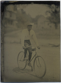 fp5458(TT_AfricanAmerican_Man_Bicycle)