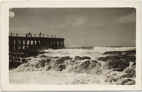 SUPERB OCEAN WAVES BREAK over ROCKS against SHORE and WOODEN PIER JETTY