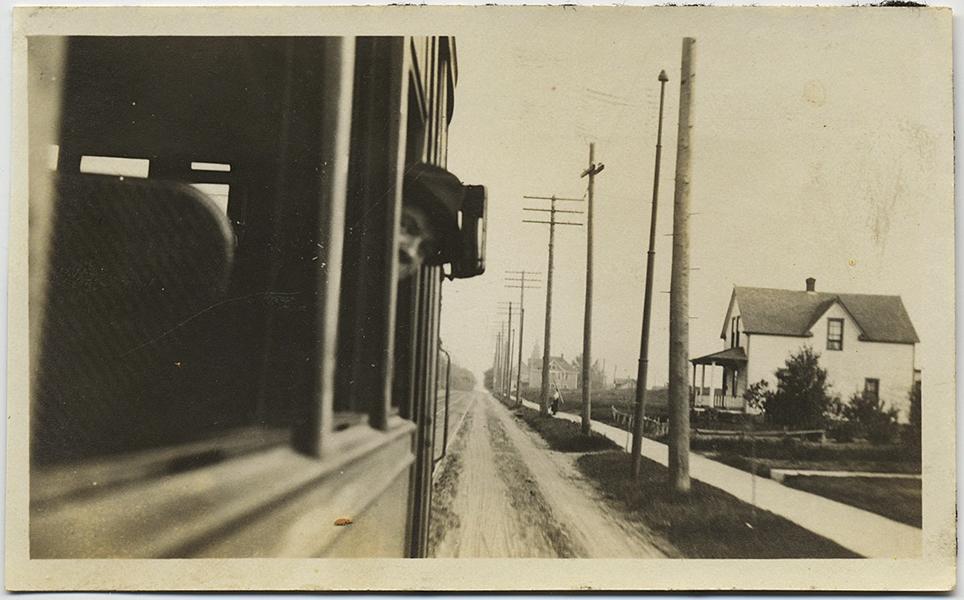fp8885(Woman-Leans-Train-Window)