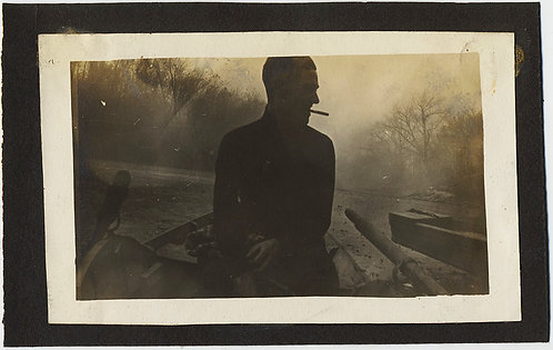 SILHOUETTED SMOKING MAN in PROFILE on ROWING BOAT MOODY EVOCATIVE