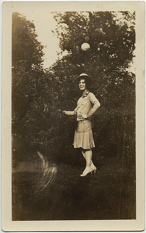 WONDERFUL WOMAN POSES AGAINST BUSH w SUSPENDED BALL HOVERING in MID AIR