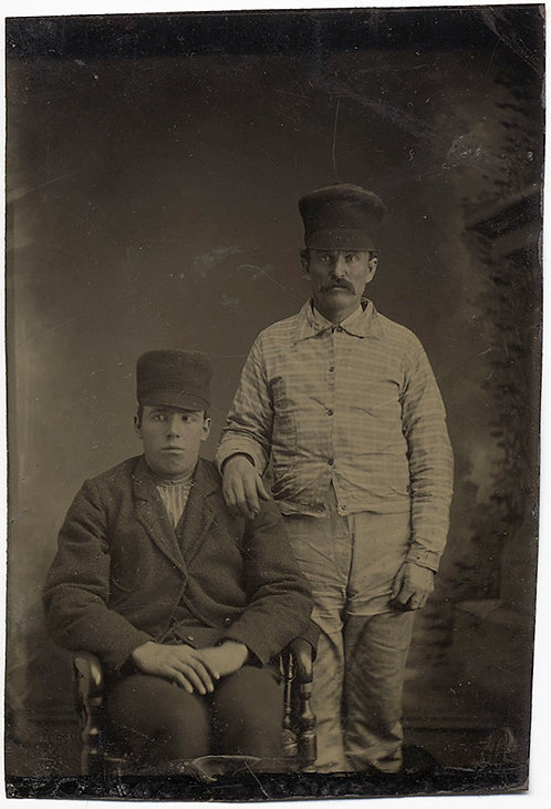 TWO FORMAL WORKERS SIT for STOLID STUDIO PORTRAIT in STUNNING CAPS